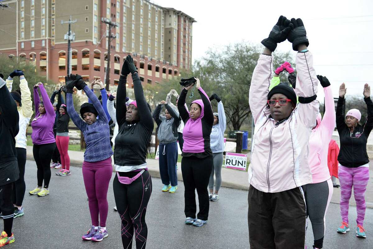 Runners stretch out before a Black Girls Run group run at Valero trailhead on Saturday, Jan. 3. The group, based in Atlanta, has had chapters in San Antonio for the past three years, holding group runs in different parts of the city nearly every day.