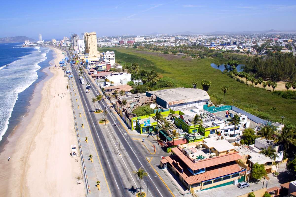 Mazatlan's malecon, the seafront walk tracing its long crescent beach, is one of the world's longest at more than 14 miles.