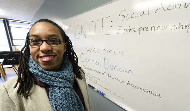 Carmen Duncan at Brown School Wednesday in Schenectady. Duncan discussed how to establish nonprofit companies that will give back to the world with middle school students. (Skip Dickstein/Times Union)