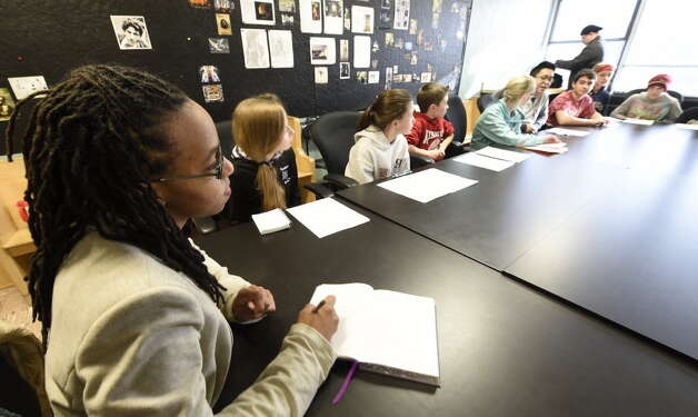 Carmen Duncan speaks to middle school students at Brown School Wednesday in Schenectady. The discussion focused on how to establish nonprofit companies that will give back to the world. (Skip Dickstein/Times Union)