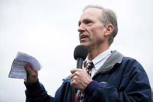 """Brian Judy, the National Rifle Association's Olympia lobbyist, speaks to gun rally.  """"What it's really about is a government list of law-abiding gun owners."""" Second Amendment supporters Thursday in Olympia."""