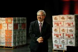 Mayor Ed Lee, flanked by boxes of fruit at the Wholesale Produce Market, reports on the State of the City.
