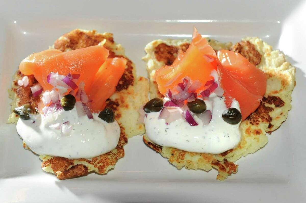 Potato Salmon Cakes with fresh smoked salmon and dill sauce with capers and red onion on Thursday, Jan. 8, 2015, at O'Briens Public House in Troy, N.Y. (Cindy Schultz / Times Union)