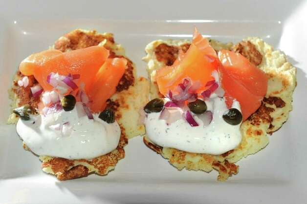 Potato Salmon Cakes with fresh smoked salmon and dill sauce with capers and red onion on Thursday, Jan. 8, 2015, at O'Briens Public House in Troy, N.Y. (Cindy Schultz / Times Union) Photo: Cindy Schultz / 00030119A