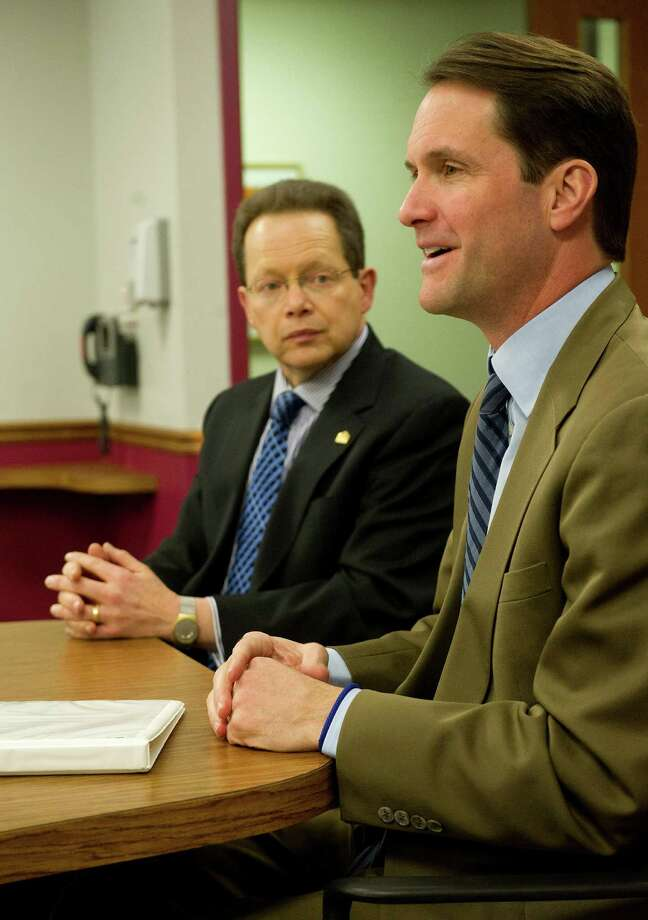Rep. Jim Himes, right, speaks alongside Norwalk Community College President David Levinson during a press conference Thursday, January 15, 2015, at the school during which Himes announced he invited Levinson to be his guest for the State of the Union. Himes and Levinson spoke in support of President Barack Obama's proposal to make the first two years of community college free. Photo: Lindsay Perry / Stamford Advocate