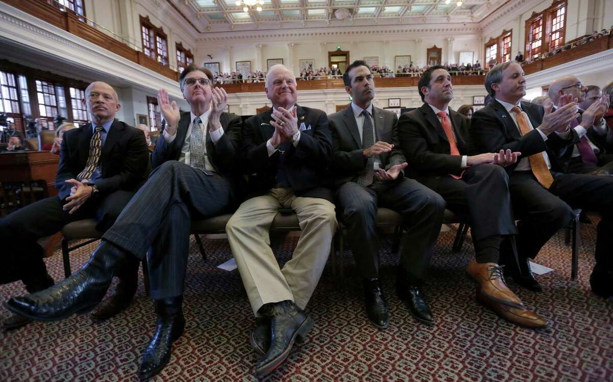 Texas Lt. Gov.-elect Dan Patrick, second from left, Agriculture Commissioner Sid Miller, Land Commissioner George P. Bush, Comptroller Glenn Hagar and Attorney General Ken Paxton applaud Gov. Rick Perry during his farewell address to a joint session of the Texas Legislature, Thursday, Jan. 15, 2015, in Austin, Texas. (AP Photo/Eric Gay)