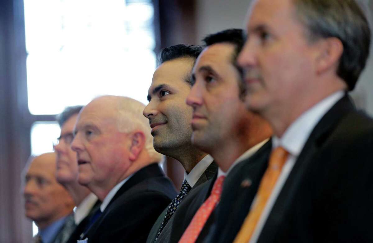 Texas Agriculture Commissioner Sid Miller, third from left, Land Commissioner George P. Bush, Comptroller Glenn Hagar and Attorney General Ken Paxton listen to Gov. Rick Perry's farewell address to a joint session of the Texas Legislature, Thursday, Jan. 15, 2015, in Austin, Texas. (AP Photo/Eric Gay)