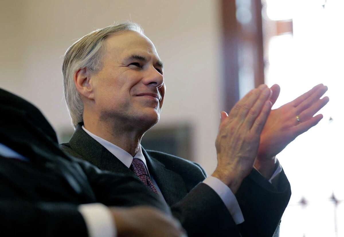 Then-Gov.-elect Greg Abbott clapped for Gov. Rick Perry during a farewell speech to a joint session of the Texas Legislature on Jan. 15.