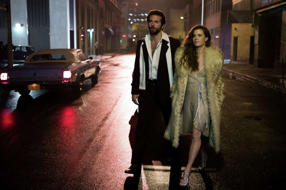 "This film image released by Sony Pictures shows Bradley Cooper, left,  as Richie Dimaso and Amy Adams as Sydney Prosser in Columbia Pictures' ""American Hustle."" Cooper's suit and scarf are vintage, and his shirt was made for the film. Adams' dress was made for the film. Her shoes, jewelry, and fur are vintage.  (AP Photo/Sony - Columbia Pictures, Francois Duhamel) ORG XMIT: CAET559 Photo: Francois Duhamel / Sony Pictures"