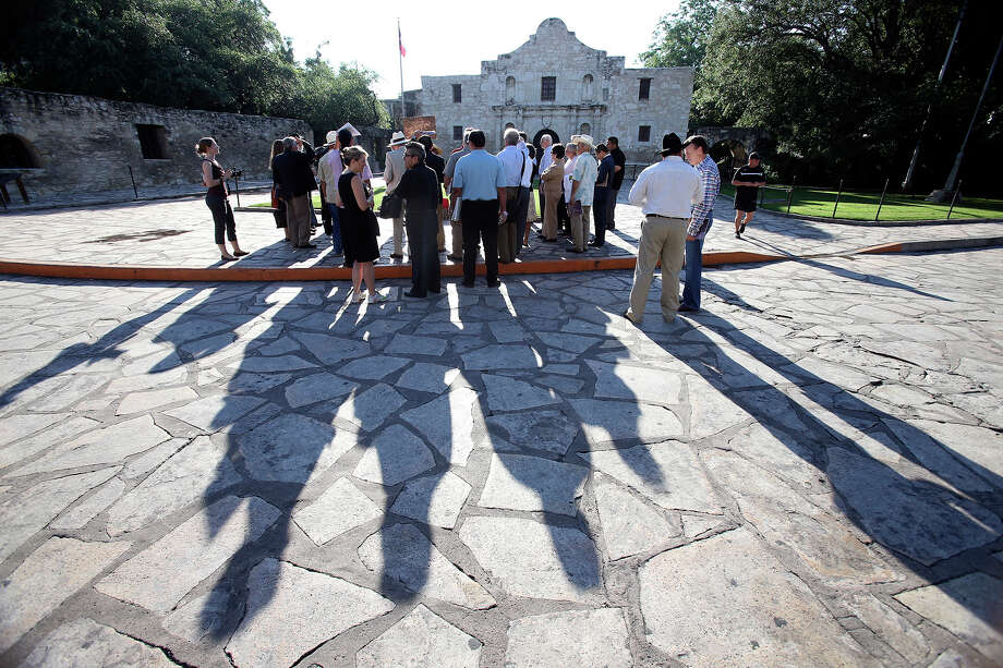 The Alamo Plaza Advisory Committee toured the site in 2014 in preparation for setting the guidelines to enable a new master plan, a historic opportunity to improve the city-owned plaza. Photo: TOM REEL /San Antonio Express-News / San Antonio Express-News