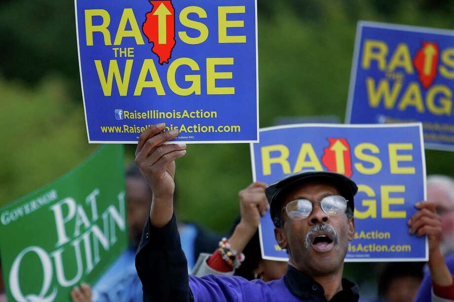 In the 13 states that boosted their minimum wages at the beginning of 2014, the number of jobs grew an average of 0.85 percent from January through June. In October 2014, supporters of raising the minimum wage rallied outside a gubernatorial debate. In November, Illinois voters approved an advisory referendum that called for the state's minimum wage to increase to $10 per hour. Photo: Seth Perlman /Associated Press / AP
