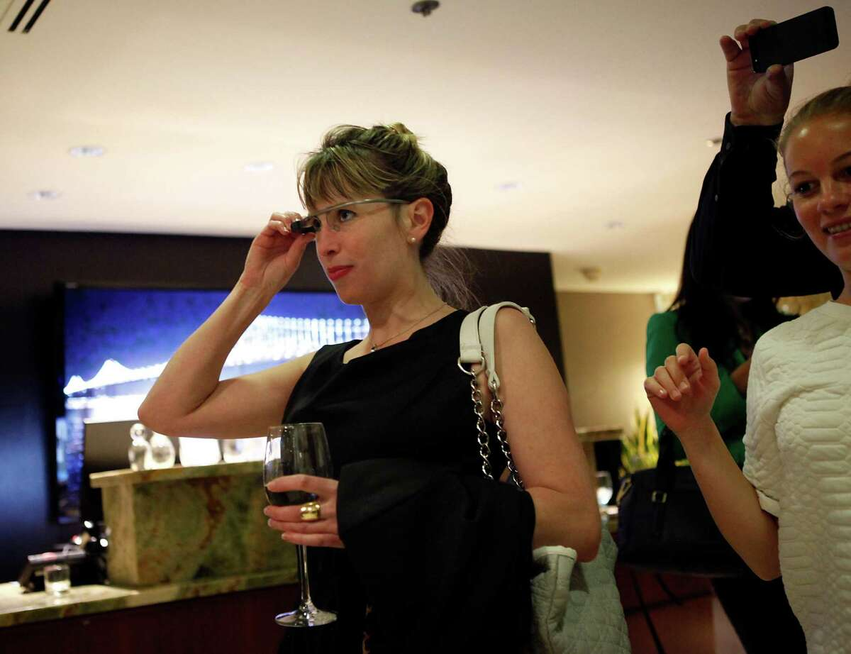 Sarah Slocum takes a picture with Google Glasses during a Google Glass meet-up in San Francisco in March. Detractors deride the devices as emblematic of class conflict.