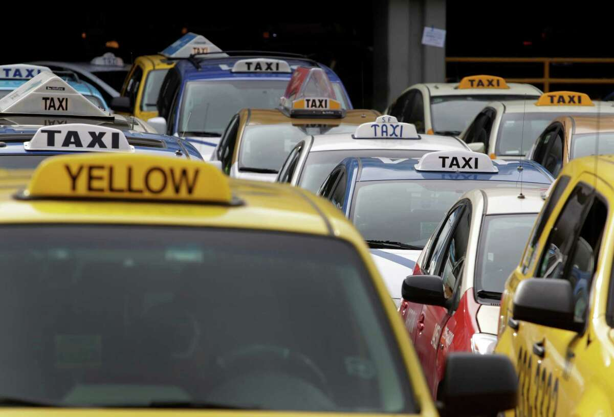 Cabs line up in a staging area before being released to taxi stands at SFO in San Francisco, Calif. on Tuesday, Nov. 18, 2014. Taxi drivers held a demonstration at the airport Monday night protesting against ride share services picking up and droping off passengers.