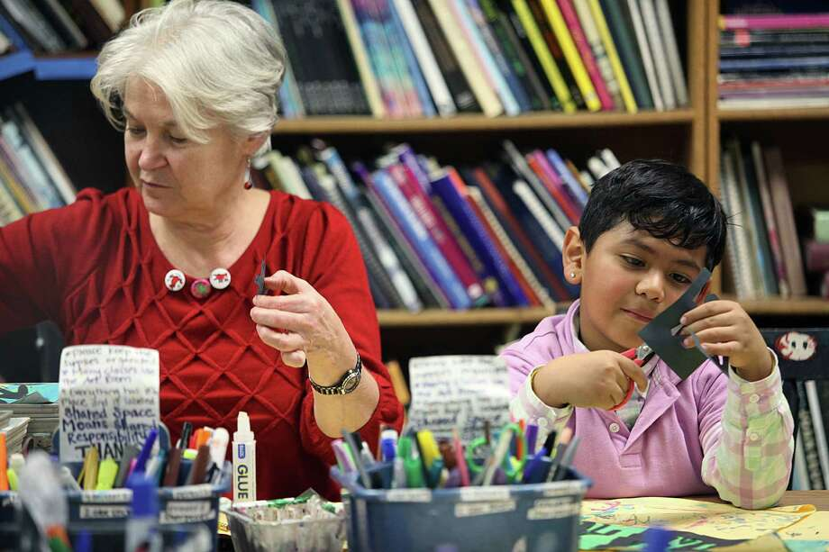 Second grade teacher Prudence Hull (left) and Lisandro Santos (right), 7 years old, work on creating a Keith Haring pop art piece in art teacher Ellen Weinstein's class at Clarendon elementary school in San Francisco, Calif., on Wednesday, January 14, 2015. Photo: Liz Hafalia / The Chronicle / ONLINE_YES