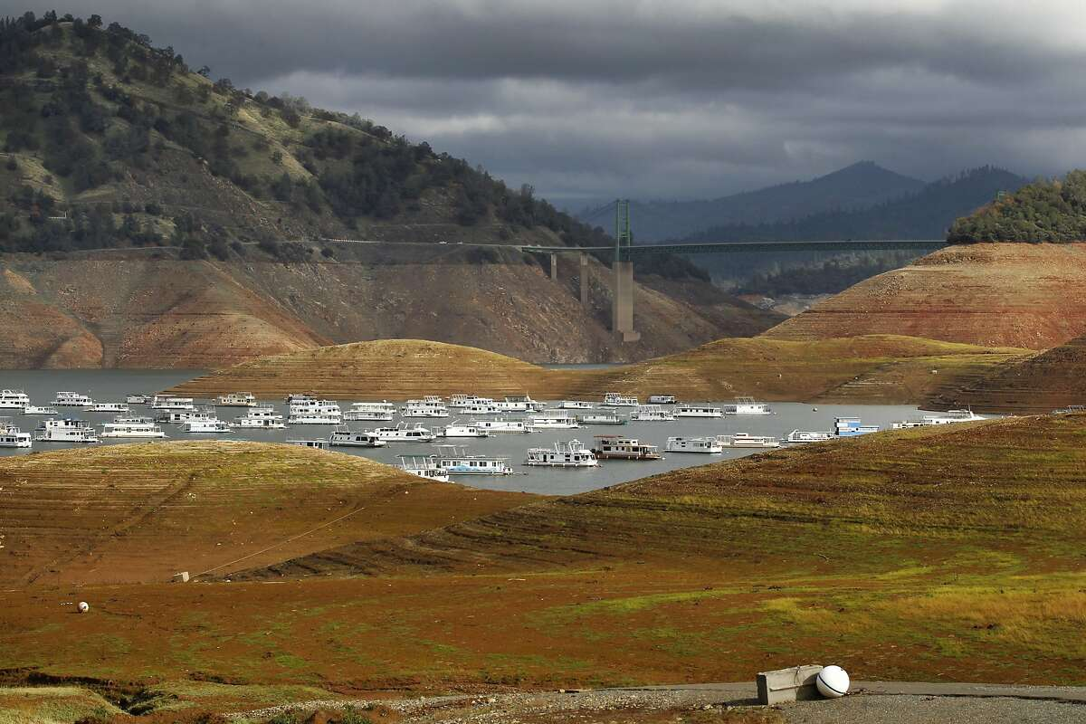 House boats sit idle in the low water of Lake Oroville with Bidwell Bar Bridge in the background Nov. 29, 2014 in Oroville, Calif. Despite recent rainfall, California's second largest reservoir is near the 1977 historic low at 26 percent of capacity.