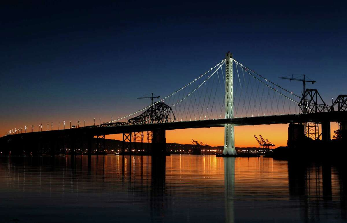 The new eastern span of the Bay Bridge is illuminated at daybreak on Dec. 23.
