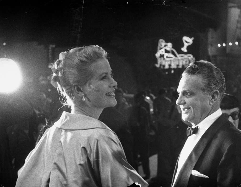 Actress Grace Kelly chatting w. her escort Paramount producer Don Hartman as they arrive at the 27th annual Academy Awards ceremony at the RKO Pantages theater. Photo: George Silk, The LIFE Picture Collection/Gett