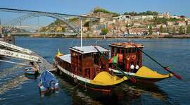 Traditional   rabelos   await passengers on the banks of the Douro, with tours offering a look at all six of hilly Porto's bridges.
