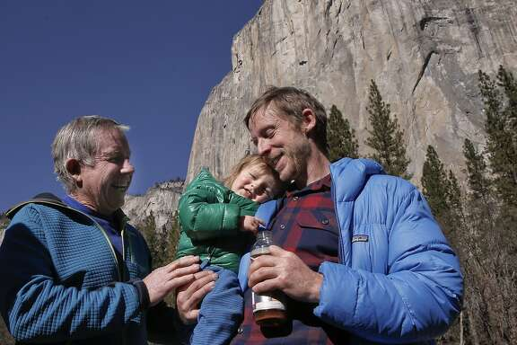 Climber Kevin Jorgeson holds his 21 month old son Fritz,  joined by his father Mike Caldwell, on Thurs. Jan. 15, 2015, during a press conference after yesterday's climb up the face of El Capitan in Yosemite National Park, Calif.