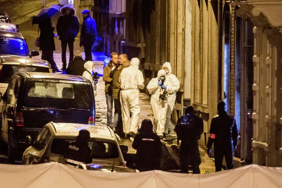 Police secure a street in Verviers, Belgium, where a shootout Thursday left two people dead and one in custody. The raid was part of an anti-terrorist operation. Photo: Geert Vanden Wijngaert, STR / AP