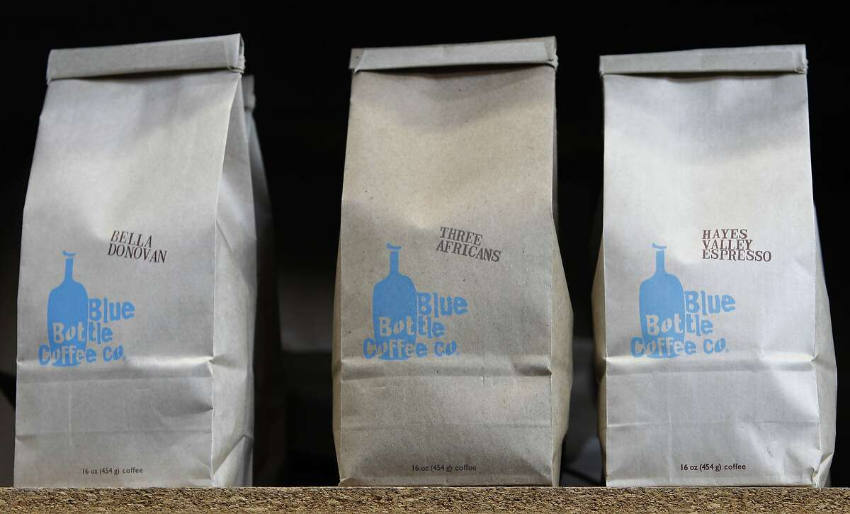 Bags of fresh roast coffee beans are ready for retail at the Blue Bottle Coffee roasting plant in Oakland, Calif. on Wednesday, Jan. 14, 2015