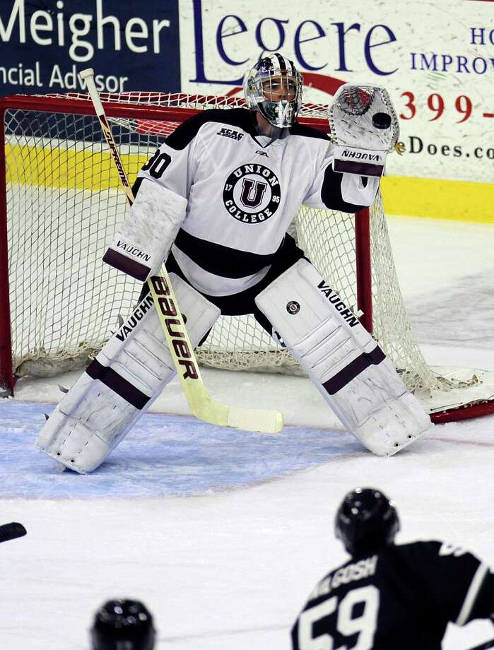 Union goaltender Colin Stevens (30) gloves a Prince Edward Island shot on goal during the first period of an exhibition hockey game on Sunday, Oct. 5, 2014, in Schenectady, N.Y. (Hans Pennink / Special to the Times Union) ORG XMIT: HP103 Photo: Hans Pennink / Hans Pennink