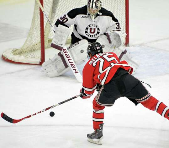 RPI's #25 Drew Melanson's shot is stopped by Union goalie #30 Colin Stevens during Saturday's game at Messa Rink Nov. 1, 2014, in Schenectady, NY.  (John Carl D'Annibale / Times Union) Photo: John Carl D'Annibale / 00029290B