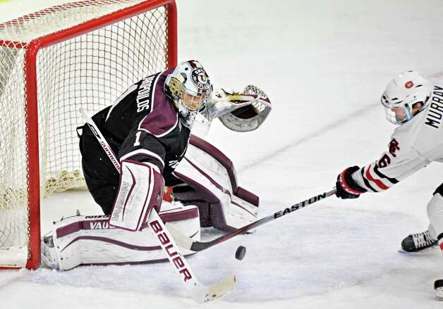 Union goalie Alex Sakellaropoulos, left, stops a shot on goal by St. Cloud State's Jimmy Murray during Saturday's game at Messa Rink Oct. 25, 2014, in Schenectady, NY.  (John Carl D'Annibale / Times Union) Photo: John Carl D'Annibale / 00029151B
