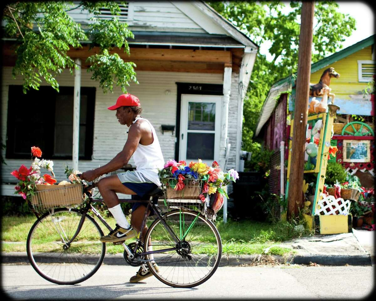 Cleveland Turner, also known as Flower Man, rode his bike in search of cast-off junk that he turned into art.