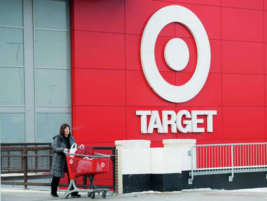 Shopper Laura Steele leaves a Target store in Toronto on Thursday, Jan. 15, 2015. More than 17,600 Target employees will eventually lose their jobs when the U.S. discount retailer closes its 133 Canadian stores after only about two years to end financial losses that went as high as a billion dollars a year. (AP Photo/The Canadian Press, Nathan Denette) ORG XMIT: NSD101 Photo: Nathan Denette / CP