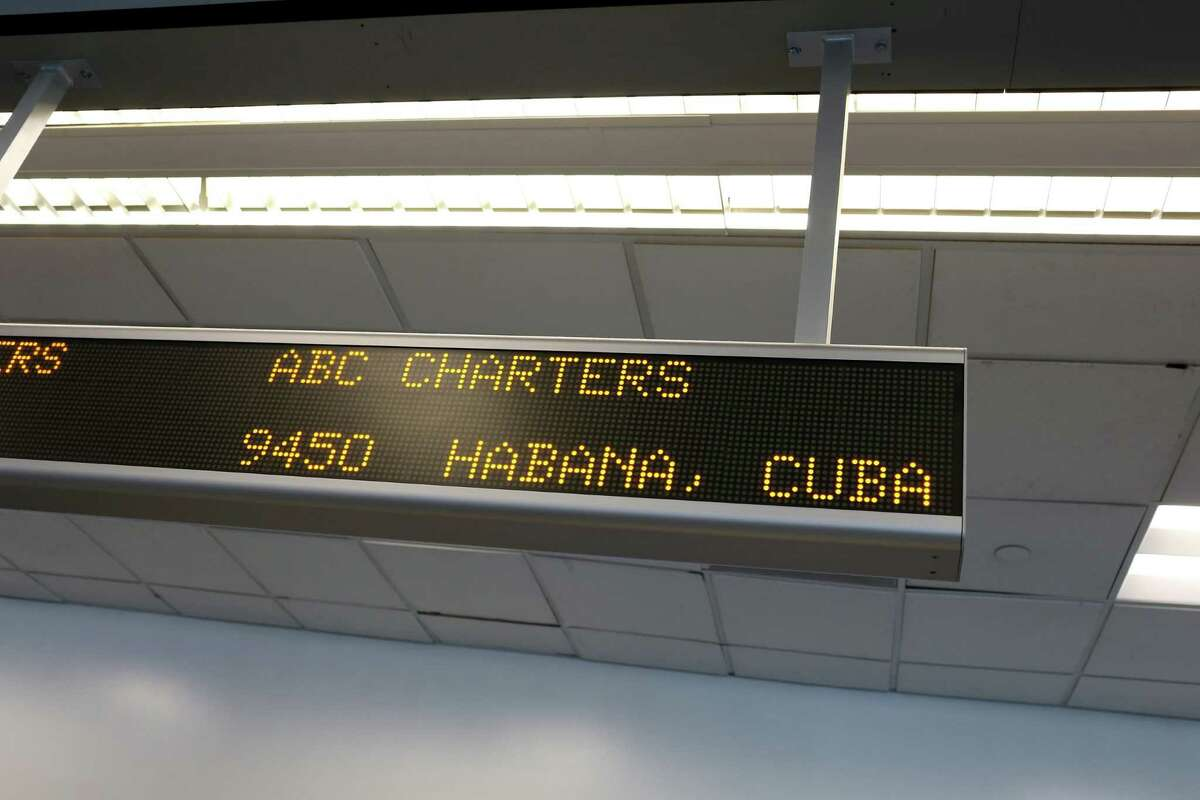 A sign late last year at Miami International Airport lists the ABC Charters-American Airlines flight to Havana. More travel from the U.S. to Cuba is ahead.