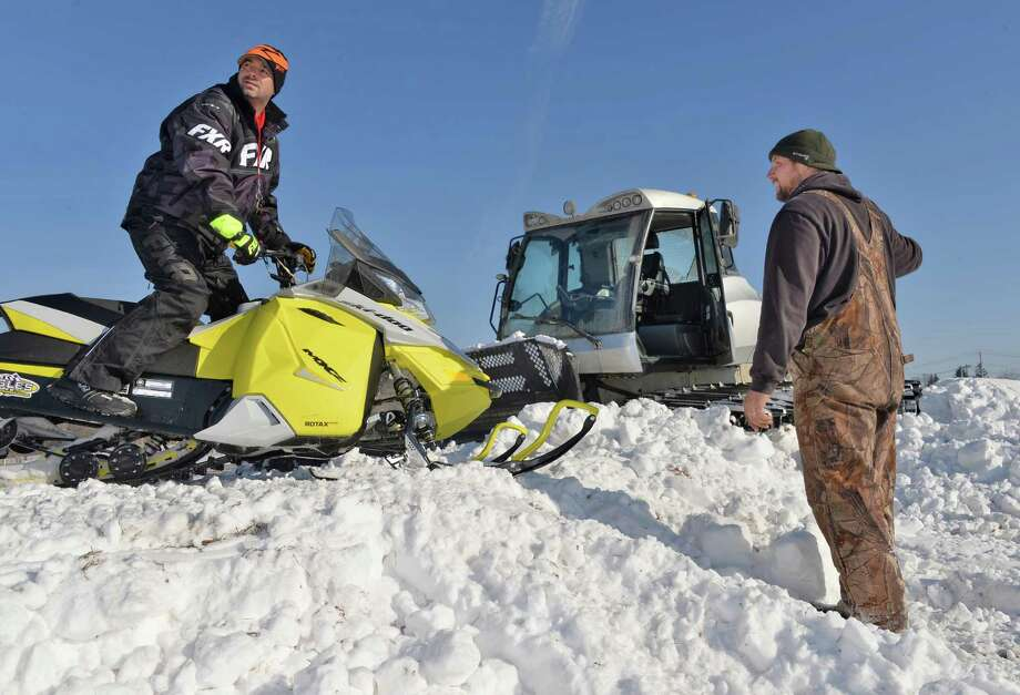 Race director Shawn Achilles, left, and East Coast Snocross owner Kurt Gagne oversee preparations for a weekend snocross event at the Schaghticoke Fair Grounds Thursday Jan. 15, 2015, in Schaghticoke, NY.  (John Carl D'Annibale / Times Union) Photo: John Carl D'Annibale / 00030213A