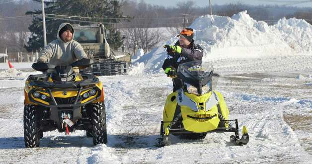 Track worker John Dixleft, and race director Shawn Achilles prepare for a weekend East Coast Snocross event at the Schaghticoke Fair Grounds Thursday Jan. 15, 2015, in Schaghticoke, NY.  (John Carl D'Annibale / Times Union) Photo: John Carl D'Annibale / 00030213A