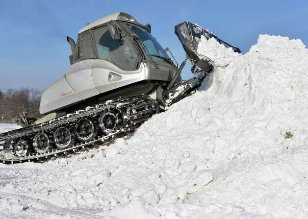 Crews from East Coast Snocross use a Prinoth snow groomer to prepare the Schaghticoke Fair Grounds for a weekend snocross event Thursday Jan. 15, 2015, in Schaghticoke, NY.  (John Carl D'Annibale / Times Union) Photo: John Carl D'Annibale / 00030213A