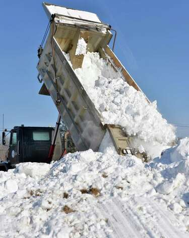 Crews from East Coast Snocross pile up tons of snow to prepare the Schaghticoke Fair Grounds for a weekend snocross event Thursday Jan. 15, 2015, in Schaghticoke, NY.  (John Carl D'Annibale / Times Union) Photo: John Carl D'Annibale / 00030213A