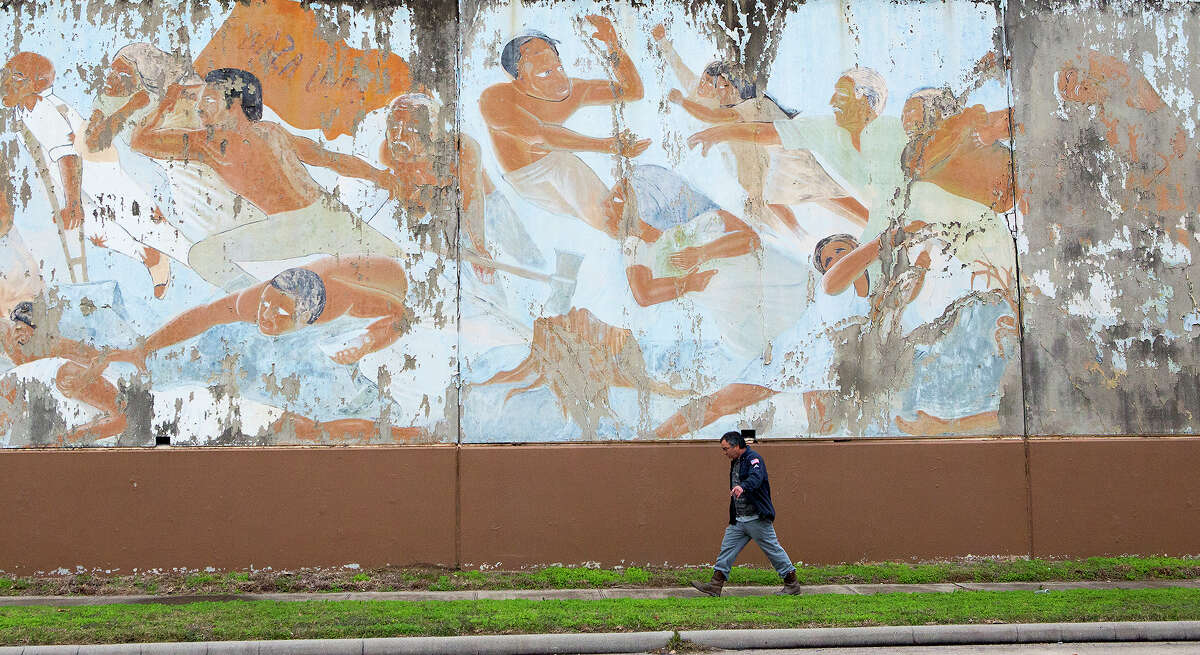 """""""The Rebirth of Our Nationality"""" mural, by famed muralist Leo Tanguma, depicts the Chicano Movement and has been an icon in the East End since 1973. (Cody Duty / Houston Chronicle)"""