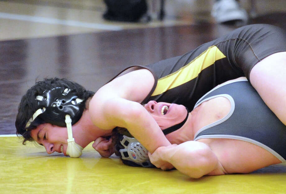 Brunswick's  Emmett Bell, left, gets the better of screaming Hackley wrestler, Giovanni Crispi, in the 126 pound weight class match in the high school wrestling match between Brunswick School and Hackley School at Brunswick in Greenwich, Conn., Thursday, Jan. 15, 2015. Photo: Bob Luckey / Greenwich Time