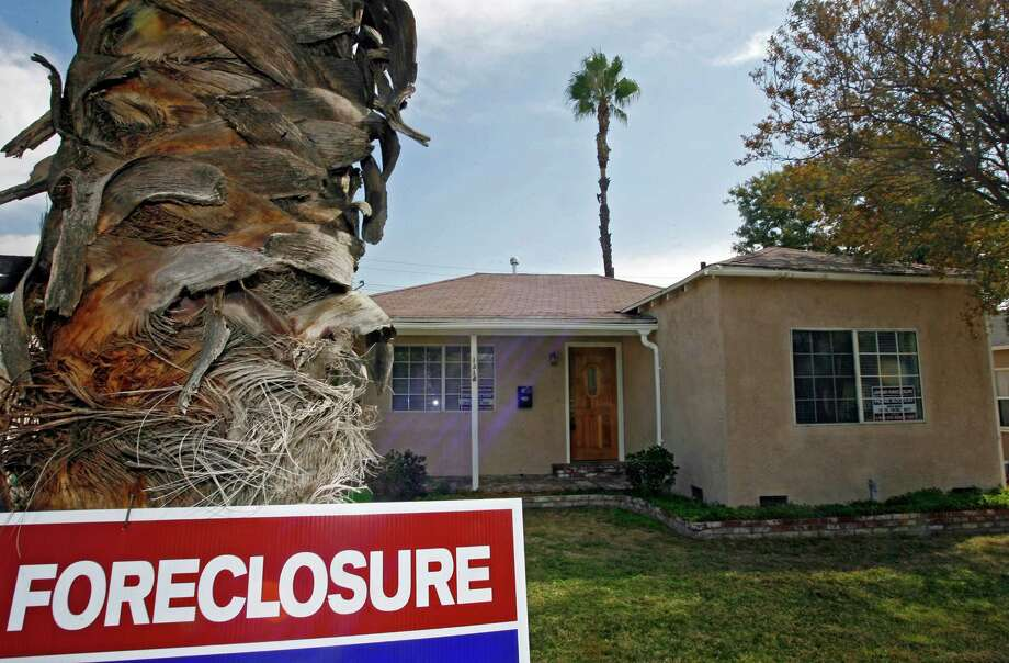 The number of U.S. homes repossessed by banks fell 29 percent last year to the lowest level since 2006, a year before the subprime mortgage crisis erupted, according to data released Thursday by foreclosure listing firm RealtyTrac Inc. Photo: Associated Press File Photo / AP
