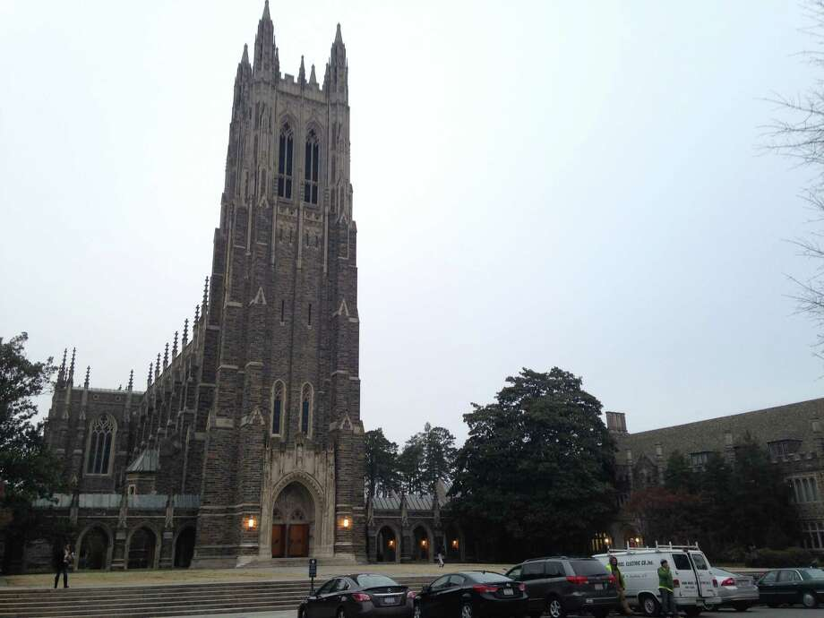 This Thursday, Jan. 15, 2015 photo shows Duke Chapel in Durham, N.C. On Thursday, just days after announcing that a traditional Muslim call to prayer would echo from the historic chapel tower, Duke University changed course after being bombarded with calls and emails objecting to the plan. Instead, Muslims will gather for their call to prayer in a grassy area in front of the chapel before heading into a room in the chapel for their weekly prayer service on Friday. (AP Photo/Jonathan Drew) Photo: Jonathan Drew, STF / AP