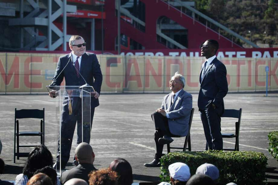 Randy Brant (left), executive vice president of Macerich, speaks alongside Mayor Ed Lee and Kofi Bonner, president of Lennar's San Francisco division, during a news conference in the Candlestick Park parking lot on Nov. 17. Photo: Lea Suzuki / The Chronicle / ONLINE_YES