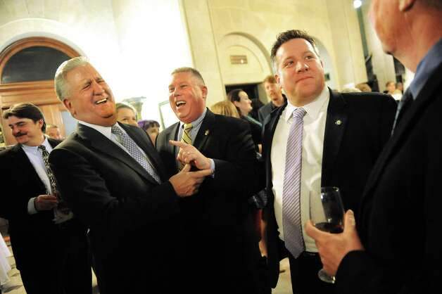 Former Albany Mayor Jerry Jennings, second from left, runs into his friends Assemblyman John T. McDonald III, center, and Albany County Executive Dan McCoy as they kick off the 6th Anniversary Albany Chefs' Food & Wine Festival: Wine & Dine for the Arts on Thursday, Jan. 15, 2015, at City Hall in Albany, N.Y. This year's beneficiaries are the Albany Barn, Albany Institute of History & Art, Capital Repertory Theatre, The Palace Theatre and Park Playhouse. Events continue Friday and Saturday For more information visit http://www.albanywinefest.com. (Cindy Schultz / Times Union) Photo: Cindy Schultz / 00030228A