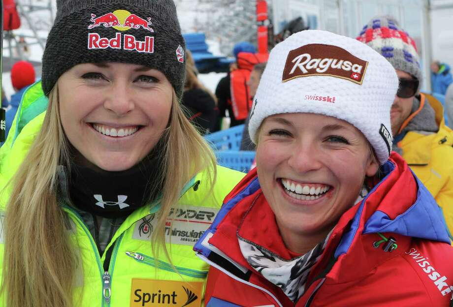 Lindsey Vonn, left, of the United States, Switzerland's Lara Gut stand in the finish area during a training session for an alpine ski women's World Cup downhill event  in Cortina, Italy, Thursday, Jan. 15, 2015. (AP Photo/Armando Trovati) ORG XMIT: COR107 Photo: Armando Trovati / AP