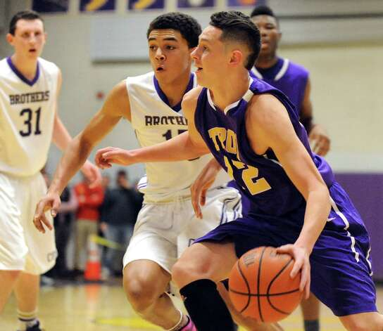 Troy's Zach Radz, right, controls the ball as CBA's Mike Wynn defends sduring their basketball game on Friday, Jan. 9, 2015, at Christian Brothers Academy in Colonie, N.Y. (Cindy Schultz / Times Union) Photo: Cindy Schultz / 00030125A