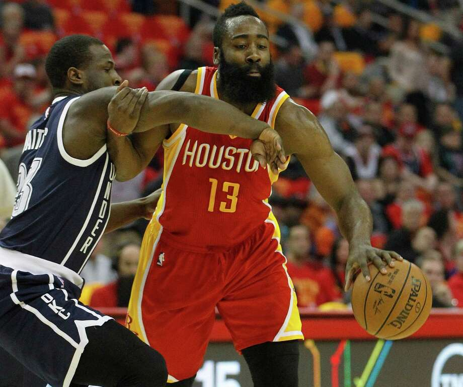 Rockets guard James Harden (13) battles the Thunder's Dion Waiters (23) at Toyota Center on Thursday night en route to a game-high 31 points. Photo: Karen Warren, Staff / © 2015 Houston Chronicle