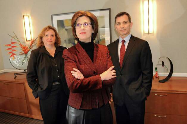 CEO Denise Gonick, center, with members of her team CFO Karla Austen, left, and Chris Del Vecchio, executive vice president of strategy and innovation, on Wednesday, Jan. 14, 2015, at MVP Health Care offices in Schenectady, N.Y. (Cindy Schultz / Times Union) Photo: Cindy Schultz / 00030111A