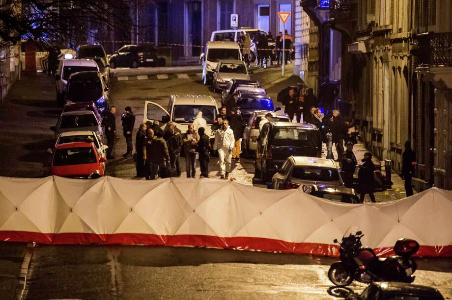 Police investigate a shootout in a street in Verviers, Belgium, Thursday, Jan. 15, 2015. Belgian authorities say two people have been killed and one has been arrested during a shootout in an anti-terrorist operation in the eastern city of Verviers. (AP Photo/Geert Vanden Wijngaert) ORG XMIT: GVW123 Photo: Geert Vanden Wijngaert / AP