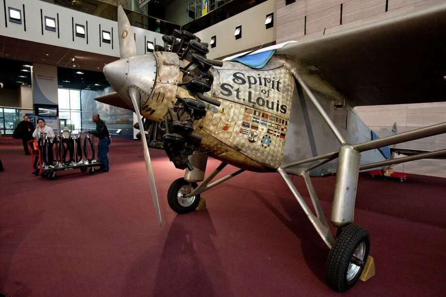 """Charles Lindbergh's """"Spirit of St. Louis"""" aircraft, one of the premiere artifacts at the National Air and Space Museum, is seen on the ground floor of the museum, Thursday, Jan. 15, 2015, after being lowered for the first time in more than 20 years to have conservation work done and giving visitors a rare chance to see it up close in Washington. Lindbergh made the first solo trans-Atlantic flight and landed in Paris in 1927. (AP Photo/Jacquelyn Martin) ORG XMIT: DCJM101 Photo: Jacquelyn Martin / AP"""