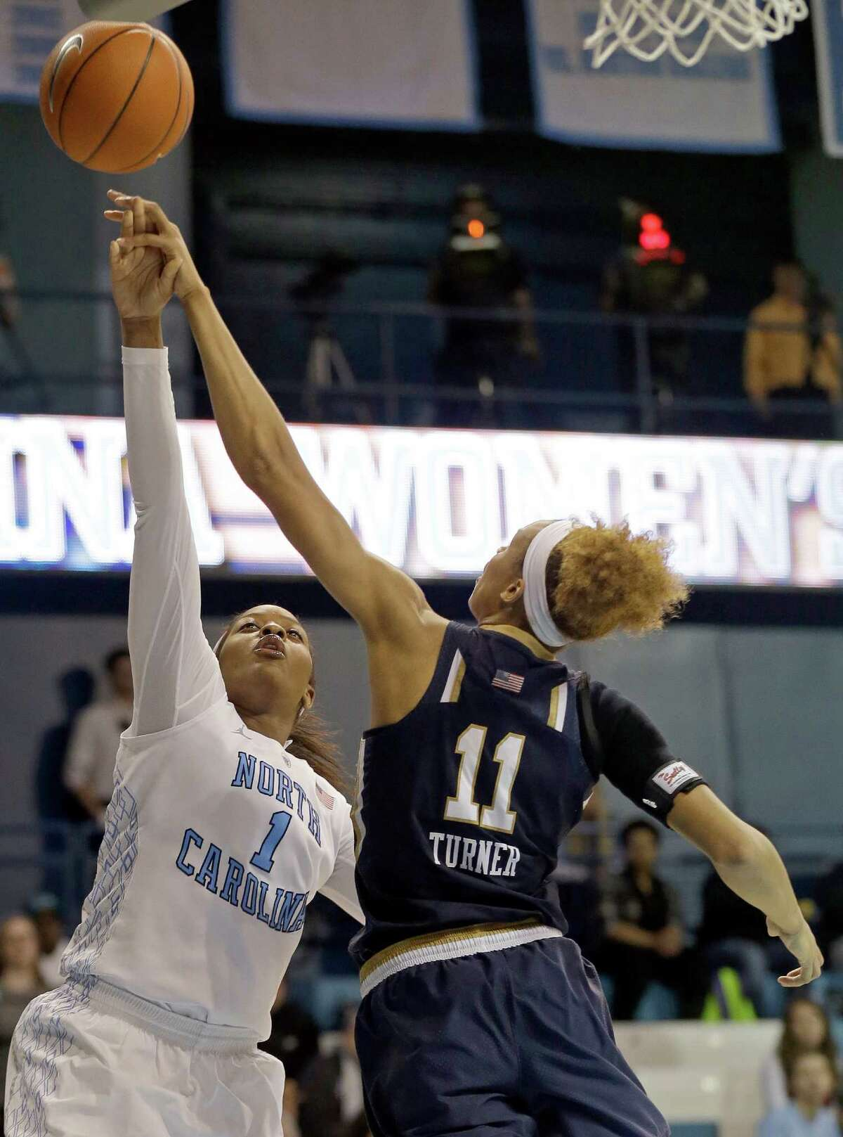 Notre Dame's Brianna Turner (11) victimizes North Carolina's Stephanie Mavunga for one of her seven blocked shots. The freshman from Manvel also had 29 points and 18 rebounds.