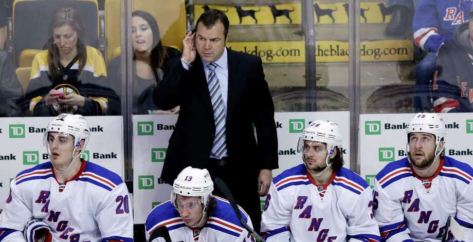 New York Rangers coach Alain Vigneault watches the final seconds of the team's 3-0 loss to the Boston Bruins in an NHL hockey game in Boston, Thursday, Jan. 15, 2015. (AP Photo/Charles Krupa) ORG XMIT: MACK116 Photo: Charles Krupa / AP