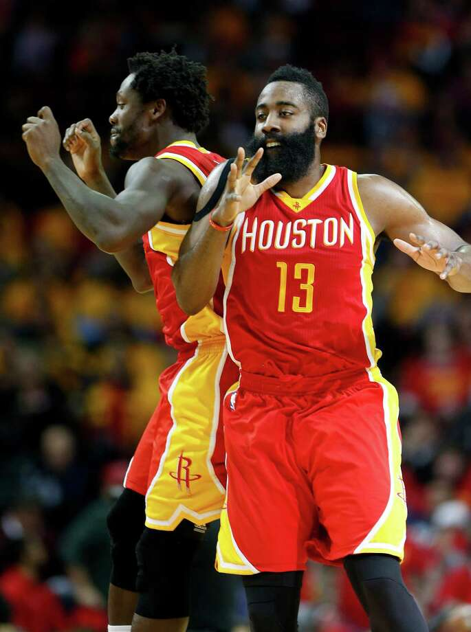Like they were most of the night, Rockets guards Pat Beverley, left, and James Harden are in sync as they celebrate upon Harden's departure from the game after a 31-point, 10-assist, nine-rebound performance. Photo: Karen Warren, Staff / © 2015 Houston Chronicle